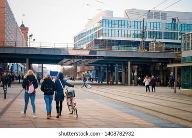 Berlin, Germany - December 10, 2017: Girls in the street in the city center of Alexanderplatz Berlin in Germany in Europe in winter.
