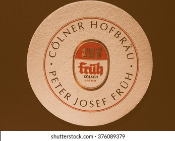 BERLIN, GERMANY - DECEMBER 11, 2014: Beermat of German beer Frueh, vintage
