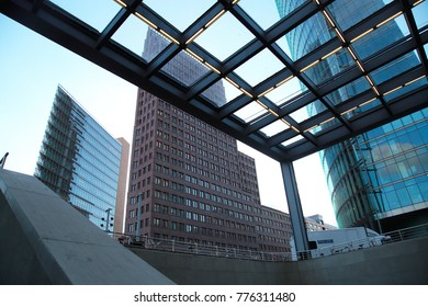 Berlin, Germany - December 11, 2017: buildings and pocile car near to railroad station Potsdamer Platz, a sightseeing and touristic place in Berlin