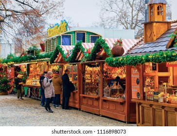 Berlin, Germany - December 12, 2017: Christmas Market at Opernpalais in Mitte in Winter Berlin, Germany. Advent Fair Decoration and Stalls with Crafts Items on the Bazaar.