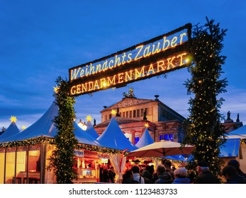 Berlin, Germany - December 13, 2017: Night Christmas Market of Gendarmenmarkt in Winter Berlin, Germany. Advent Fair Decoration and Stalls with Crafts Items on the Bazaar.
