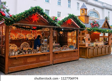 Berlin, Germany - December 13, 2017: Christmas Market in Opernpalais at Mitte in Winter Berlin, Germany. Advent Fair Decoration and Stalls with Crafts Items, on the Bazaar.