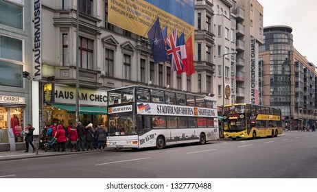 Berlin, Germany - December 15, 2018 : Berlin city tour or city sightseeing buses  parking at checkpoint charlie museum.