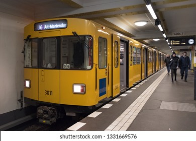Berlin, Germany - December 15, 2018 : A local Berlin metro train arriving at platform. The U-Bahn Berlin is known for its yellow-colored trains.