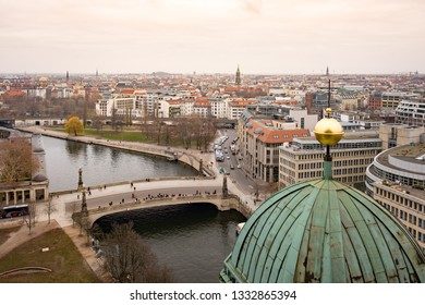 Berlin, Germany - December 15, 2018 : Aerial view of Berlin's historic city centre from the top of Berlin Cathedral (Berliner Dom), a UNESCO-designated World Heritage Site in beautiful golden light.