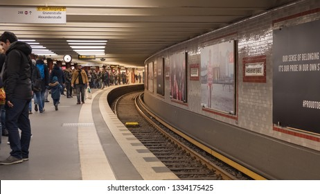 Berlin, Germany - December 15, 2018 : Passengers in Alexanderplatz U-Bahn underground station with curved railway track.