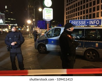 Berlin, Germany - December 19, 2016: policemen at the site of an accident in Kurfuerstendamm avenue in the west of Berlin. A truck plowing through the crowd at the Christmas market
