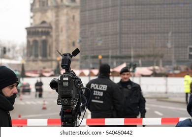Berlin, Germany - December 19, 2016: police and journalists at the site of an accident in Kurfuerstendamm avenue in the west of Berlin. A truck plowing through the crowd at the Christmas market