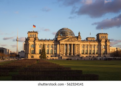 Berlin, Germany, December 2, 2016. People in front of the Reichstag - one of the most famous buildings in Berlin. The TV tower is seen at the background.