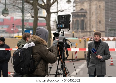 Berlin, Germany - December 20, 2016: journalists at the site of an accident in Kurfuerstendamm avenue in the west of Berlin. A truck plowing through the crowd at the Christmas market
