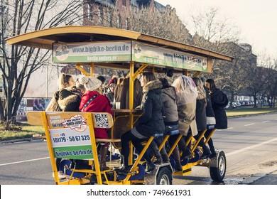 BERLIN, GERMANY - December 2016: Beer bike in Berlin downtown. People enjoying beer bike ride in Berlin, Germany