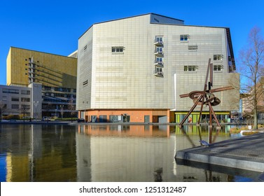 BERLIN, GERMANY - DECEMBER 2017: Outdoor scenery of pool, Piano-see, in front of Stage Theater and rusty steel sculpture on the water in Potsdamer Platz, in Berlin, Germany.