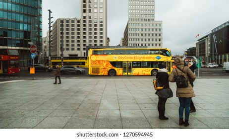 Berlin, Germany - December 2018: Potsdamer Platz place with a yellow bus in the background