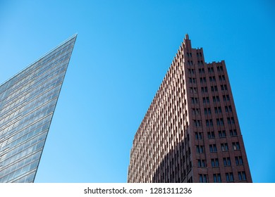 BERLIN, GERMANY- December 2018. Two modern buildings at Potsdamer Platz against the blue sky.