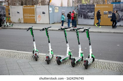 Berlin, Germany - December, 2019: E-mobility in Germany: discarded electric scooters on the streets of Berlin