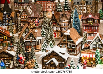 Berlin, Germany - December, 2019: Toy Christmas ceramic miniature with snow-covered city. Small festive village in Berlin, Germany.