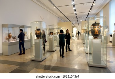 Berlin, Germany - December 2019: Visitors in the Antiquities rooms of the Altes Museum, one of the five museums in the Museumsinsel complex and a UNESCO World Heritage Site