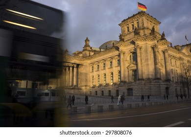 BERLIN, GERMANY - December 25, 2014.  People walking in front of the Reichstag the building that houses the Bundestag (German Federal Diet)  .