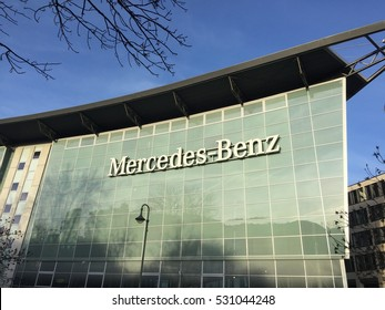 Berlin, Germany - December 3, 2016: view from outside of the Mercedes Benz dealership. Mercedes Benz is a German manufacturer of high end cars, headquartered in Stuttgart