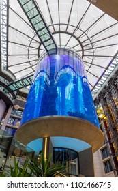 BERLIN, GERMANY - DECEMBER 31: AquaDom aquarium on December 30, 2017 in Berlin. The AquaDom in Berlin, Germany, is a 25m tall cylindrical acrylic glass aquarium with built-in transparent elevator.