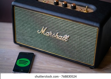 Berlin, Germany- December 3.,2017.: Marshall amp linked by bluetooth to smartphone. Spotify mobile application on smartphone.
