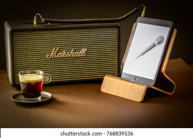Berlin, Germany- December 3.,2017.Marshall amp linked to tablet computer and a cup of coffee. Marshall Amplification is one of leading worldwide brand in sound amplification and musical instruments.