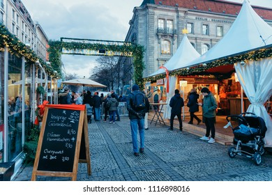 Berlin, Germany - December 8, 2017: Night Christmas Market of Gendarmenmarkt in Winter Berlin of Germany. Advent Fair Decoration and Stalls with Crafts Items on the Bazaar.