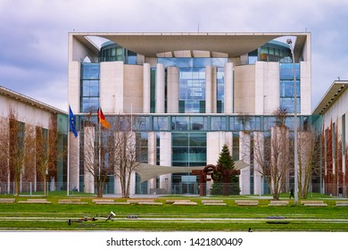Berlin, Germany - December 8, 2017: Bundeskanzleramt building with EU and German flags in Berlin Mitte, capital of Germany in winter in the street. Government house architecture.