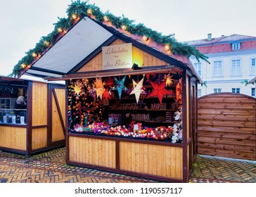 Berlin, Germany - December 9, 2017: Star lantern decorations on Christmas Market at Charlottenburg Palace in Winter Berlin, Germany. Advent Fair Decoration and Stalls with Crafts Items on the Bazaar.