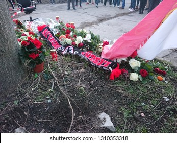 Berlin, Germany - February 11, 2019: Union Berlin football club fans mourn a young fan stabbed two days before in the parking lot of the Netto supermarket branch in Stahlheimer Straße, Prenzlauer Berg