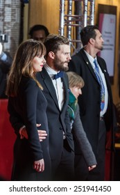 BERLIN, GERMANY - FEBRUARY 11: Jamie Dornan and Dakota Johnson attend the 'Fifty Shades of Grey' premiere during the 65th Berlinale International Film Festival at Zoo Palast on February 11, 2015