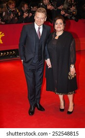 BERLIN, GERMANY - FEBRUARY 13, 2015: Kenneth Branagh and wife Lindsay Brunnock attend the 'Cinderella' premiere during the 65th Berlinale International Film Festival at Berlinale Palace