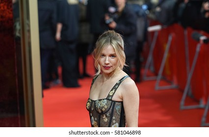 Berlin, Germany - February 14, 2017: Sienna Miller, attractive actress in the movie The Lost City of Z, on red carpet during the 67th Berlinale International Film Festival of Berlin