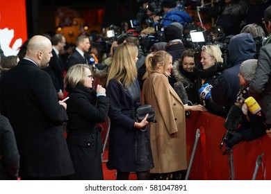 Berlin, Germany - February 14, 2017: actress Sienna Miller interviewed on red carpet during the 'The Lost City of Z' premiere at 67th Berlinale International Film Festival