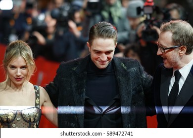 Berlin, Germany - February 14, 2017: Sienna Miller, Robert Pattinson and James Gray,  director and cast of The Lost City of Z, on red carpet at the Berlinale photo call