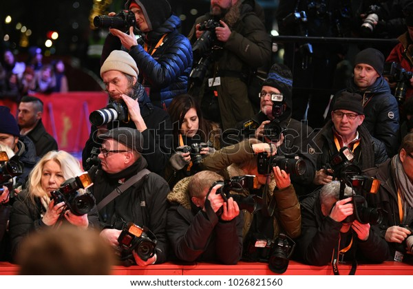 Berlin, Germany - February 16, 2018: Crowd of paparazzi waiting for celebrities during the 68th edition of the Berlinale International Film Festival