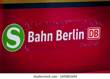 BERLIN, GERMANY. February 16, 2020. Traditional yellow red S-Bahn city trains in Berlin arriving to the Treptower Park station. S Bahn Berlin logo seen on the side of the train car.