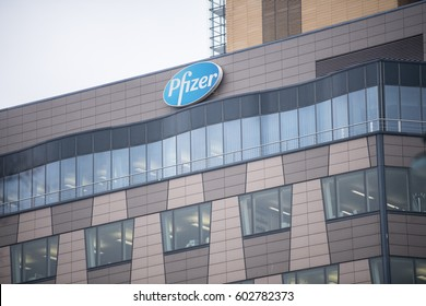 Berlin, Germany - February 17, 2017: Pfizer signage on building exterior. Pfizer is an American global pharmaceutical corporation. It is among the world's largest pharmaceutical companies