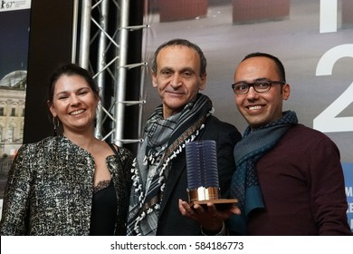 Berlin, Germany - February 18, 2017: Producer Palmyre Badinier poses with director Raed Andoni, winner of Glashuette Original Documentary Award, and assistant director Wadee Hanani during Berlinale