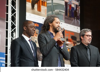 Berlin, Germany - February 18, 2017: Director  Alain Gomis with producers Arnaud Dommerc and Oumar Sall after being awarded with Silver Bear Grand Jury Prize for his movie 'Felicite' during Berlinale