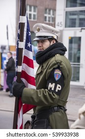 BERLIN, GERMANY - FEBRUARY 20, 2014: Young man, dressed as an American military policeman, from World War II, at Checkpoint Charlie