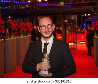Berlin, Germany - February 20, 2016  - Majd Mastoura, winner of the Silver Bear for Best Actor for 'Inhebbek Hedi', poses with his award after the closing ceremony of the 66th Berlinale