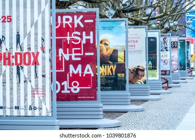 Berlin, Germany - February 22, 2018: Posters advertising the upcoming films on the Potsdamer Platz during the 68th Berlinale International Film Festival 2018 in Berlin
