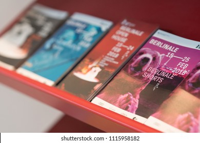 Berlin, Germany - February 22, 2018: flyers and brochures of 68th Berlinale - Berlin International Film Festival 2018. The bear is the symbol of the Festival