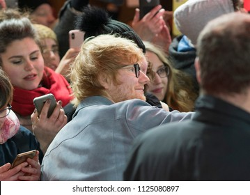 Berlin, Germany - February 23, 2018: Ed Sheeran poses for a selfie with a fan while attending the 'Songwriter' premiere during the 68th Berlinale International Film Festival Berlin 2018