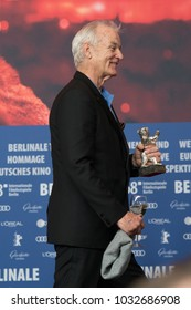Berlin, Germany - February 24, 2018: Bill Murray, accepting the award for Wes Anderson (winner of the Silver Bear for Best Director for 'Isle of Dogs'), at the Berlinale Award Winners press conference