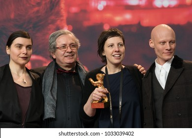 Berlin, Germany - February 24, 2018: Bianca Oana, Philippe Avril, Adina Pintilie and Tomas Lemarquis pose with the Golden Bear Award for Best Film 'Touch Me Not' at the Award Winners press conference