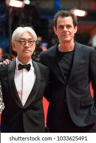 Berlin, Germany - February 24, 2018: Japanese musician and member of the jury Ryuichi Sakamoto and German jury president Tom Tykwer pose on red carpet before the awards ceremony of the 68th Berlinale