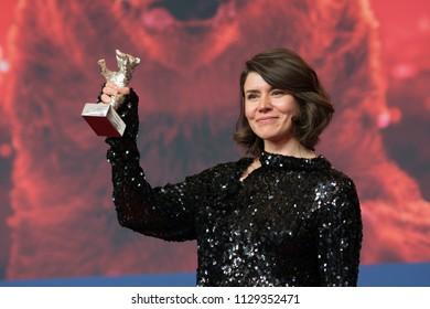 Berlin, Germany - February 24, 2018: Director Monika Szumowska shows Grand Jury Prize silver bear for her film 'Twarz' during the 68th edition of the International Film Festival Berlin