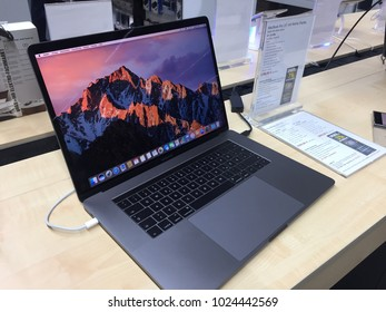 Berlin, Germany - February 7, 2018: McBook Pro computer laptop in Medimax store. Apple is an American multinational technology company that designs, develops and sells consumer electronics